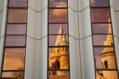 Halászbástya: Geometric Refction of the Fisherman`s Bastion in Budapest. The famous Halászbástya or Fisherman`s Bastion in Budapest, Hungary royalty free stock photography