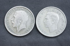 Hal crown, George V and VI. Obverse side of two half crown British coins, one of king George V (from 1920) , the other his son George VI (from 1946 stock photography