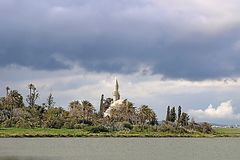 Hala Sultan Tekke or the Mosque of Umm Haram, Larnaca, Cyprus. Hala Sultan Tekke or the Mosque of Umm Haram, a Muslim shrine on the west bank of Larnaca Salt stock photos