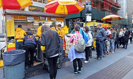 Halal Guys, Street Food. The Halal Guys is a franchise food cart Business selling Middle Eastern food,serveing meat (chicken, gyro, rice and falafel. People Royalty Free Stock Photos