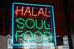 Halal Soul Food Neon. A neon sigh in a shop window in New York City advertises halal soul food for sale Royalty Free Stock Image