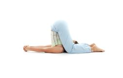 Halasana plow pose Stock Photo