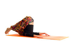 Halasana, a position in Yoga, is also called  Plow Stock Photos