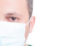 Halbe Gesichter des Mannes und der Ärztinnen Lizenzfreie Stockfotografie