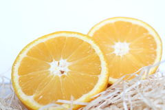 Halbe Orange des Schnittes zwei Stockbild