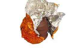 Halber ausgepackter Schokoladenschaumgummikuß Lizenzfreies Stockfoto