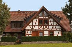 Halbes Bauholzhaus Stockbild