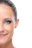 Halbes Gesicht der jungen Frau Stockfotos