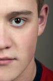 Halbes Gesicht des jungen Mannes Lizenzfreies Stockbild