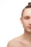 Halbes Gesicht des jungen Mannes Stockbild