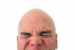 Halbes Gesicht des kahlen Mannes im weißen Hintergrund Stockfotografie