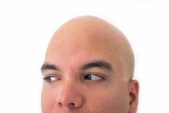 Halbes Gesicht des kahlen Mannes im weißen Hintergrund Lizenzfreies Stockbild