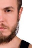 Halbes Gesicht des Mannes Stockfotografie