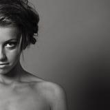 Halbes Gesichtsportrait der Frau Stockfotografie