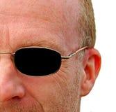 Halbes Gesichtsprofil mit Sonnenbrille Stockfotos