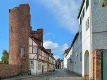 Halbturm-Haus on the street An der Mauer in Lubeck, Germany. Lubeck, Germany. Halbturm-Haus, a half-timbered house from 1672, built into the half tower of the Royalty Free Stock Image