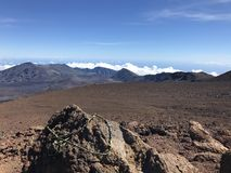 Haleakala in the background with rocks in foreground stock photography