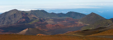 Haleakala Crater Panorama. Haleakala Volcano and Crater Maui Hawaii showing moon like surface with mountains, lava tubes, rocks, and surreal like beauty Royalty Free Stock Photos