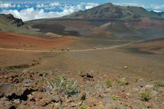 Haleakala Crater Trail. A popular way to see Haleakala Crater is by horseback on the trails deep within the crater. This image captures riders on horseback Royalty Free Stock Photos