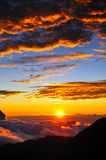 Haleakala Volcano sunset. Scenic view of colorful sunset and cloudscape viewed from summit of Haleakala volcano, Maui, Hawaiian Islands Stock Photo