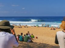 HALEIWA, UNITED STATES OF AMERICA- JANUARY 13 2015: spectators and photographers at the famous pipeline stock photography
