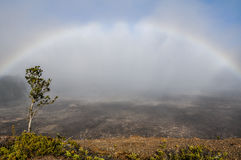 Halema'uma'u Crater. A complete rainbow over one of Kilauea's Halema'uma'u Crater at Volcanoes National Park, Hawaii Stock Photo