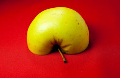 Half apple. On red tablecloth Stock Image