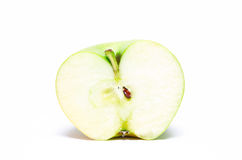 Half-apple. Bisected large and juicy green apple stock photo