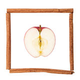 Half of an apple in a frame from cinnamon Royalty Free Stock Photography