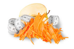 Half An Apple With Grated Carrots And Sewing Measuring Stock Photography