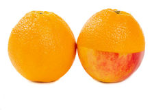 Half of an Apple and a half of an orange Stock Images