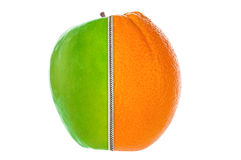 Half apple and orange joined by zipper Royalty Free Stock Photos