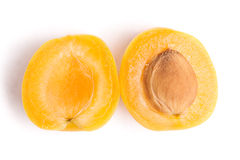 Half of apricot Stock Images
