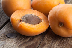 Half apricot on old wood Stock Images