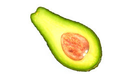 Half of avocado. A piece of fresh avocado on a white background Royalty Free Stock Images