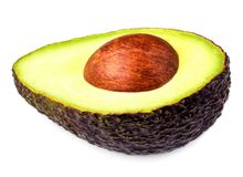 Half Avocado with core  isolated on white background macro.  Royalty Free Stock Images