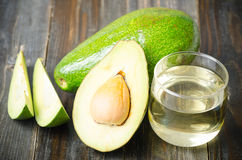 Half of avocado fruit and oil Royalty Free Stock Photography