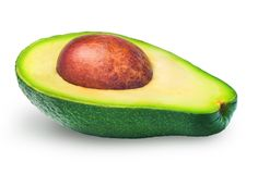 Half of avocado isolated. Avocado isolated. Half of fresh avocado fruit with brown seed isolated on white background. Clipping path Royalty Free Stock Photos