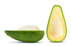 Half of avocado with leaf isolated. Isolated avocado. Two halves of fresh avocado fruit with seed isolated on white background stock images