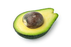 Half avocado with seed isolated on white Royalty Free Stock Photo