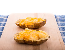 Half Baked Cheesy Potatoes Royalty Free Stock Photo