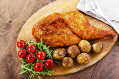 Half baked chicken Stock Photo