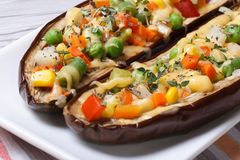 Half baked eggplants stuffed with vegetables and cheese Royalty Free Stock Images