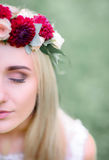 Half of beautiful bride`s face with red flowers Stock Images