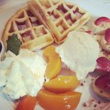 Half of belgian waffles with fruits Royalty Free Stock Photos