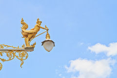 Half-bird half-woman on street lamp Royalty Free Stock Images
