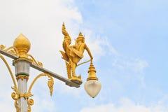 Half-bird half-woman on street lamp Royalty Free Stock Photos