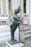 Half bird and human statue at Emerald Buddha Temple Stock Photography