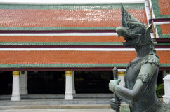 Half bird and human statue at Emerald Buddha Temple Stock Image