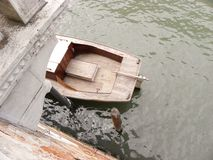 Half boat under a bridge Royalty Free Stock Photography